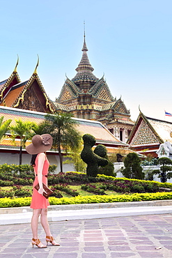 A young woman at Wat Pho temple in Bangkok, Thailand, Southeast Asia, Asia