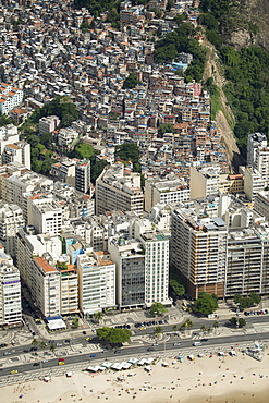 Copacabana Beach, neighbourhood and the Morro da Humaita favela behind, Rio de Janeiro, Brazil, South America