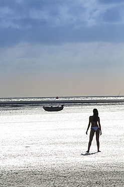 A young woman on Vila do Pesqueiro beach on Marajo island, Brazilian Amazon, Para, Brazil, South America