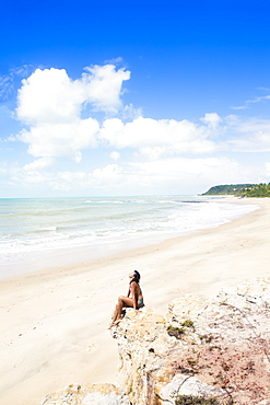A young woman on Espelho near Trancoso, Bahia, Brazil, South America