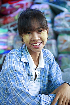 Monywa girl with traditional Burmese thanaka face paint, Monywa, Sagaing, Myanmar, Southeast Asia