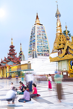 Devotees paying obeisance at the Shwedagon pagoda complex in Yangon (Rangoon), Myanmar (Burma), Southeast Asia