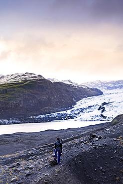Hiker in front of the Vatnajokull glacier in Vatnajokull National Park in southeast Iceland, Polar Regions