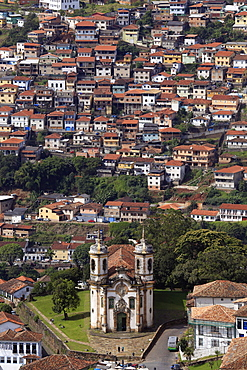View of the Sao Francisco church with poor housing behind, Ouro Preto, Minas Gerais, Brazil, South America