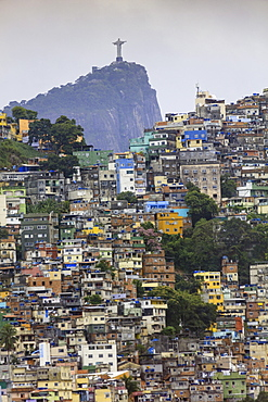 View of Rocinha favela (slum) (shanty town), Corcovado mountain and the statue of Christ the Redeemer, Rio de Janeiro, Brazil, South America