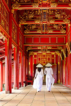 Two women in traditional Ao Dai dress and Non La conical hats in the Forbidden Purple City of Hue, UNESCO World Heritage Site, Thua Thien Hue, Vietnam, Indochina, Southeast Asia, Asia