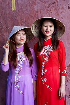Young Vietnamese women wearing a traditional Ao Dai dress, Vietnam, Indochina, Southeast Asia, Asia