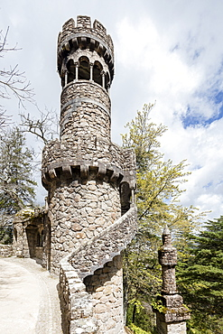 Old mystical tower of Romanesque Gothic and Renaissance style inside the park Quinta da Regaleira, Sintra, Portugal, Europe