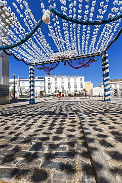 Colors and decoration in the pedestrian centre of Tavira on a sunny summer day, Faro, Algarve, Portugal, Europe