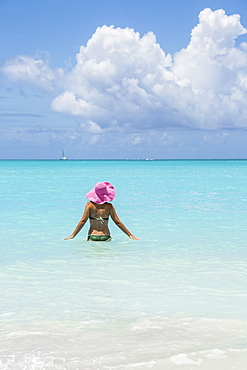 Bather in the turquoise waters of the Caribbean Sea, Jolly Beach, Antigua, Antigua and Barbuda, Leeward Islands, West Indies, Caribbean, Central America