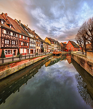 Panorama of colored houses reflected in River Lauch at sunset, Petite Venise, Colmar, Haut-Rhin department, Alsace, France, Europe