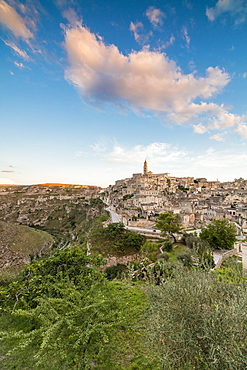 Sunset on the ancient town and historical center called Sassi, perched on rocks on top of hill, Matera, Basilicata, Italy, Europe