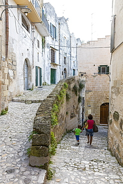 Typical stone alleys in the old town center of Matera also known as the Subterranean City, Matera, Basilicata, Italy, Europe