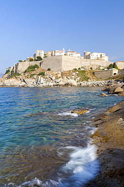 The old fortified citadel on the promontory surrounded by the clear sea, Calvi, Balagne Region, northwest Corsica, France, Mediterranean, Europe