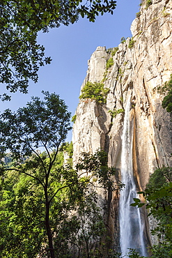 The Piscia di Gallo waterfall surrounded by granite rocks and green woods, Zonza, Southern Corsica, France, Europe