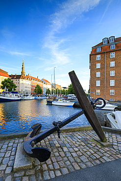 Sculpture of an anchor on the banks of Christianshavn Canal with Church of Our Saviour in the background, Copenhagen, Denmark, Europe