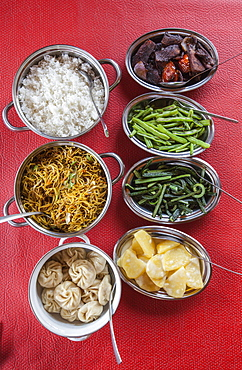 Bhutanese dishes served at a restaurant in Thimphu rice and vegetables including chilli, Bhutan, Asia