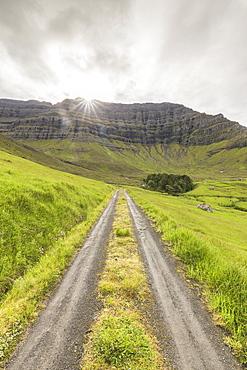 Path through green meadows, Kunoy Island, Nordoyar, Faroe Islands, Denmark, Europe