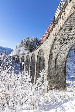 Bernina Express train on Landwasser Viadukt, UNESCO World Heritage Site, Filisur, Albula Valley, Canton of Graubunden, Switzerland, Europe