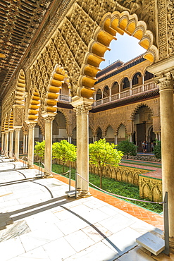 Decorated pillars and archways on side of courtyard of the Patio de las Doncellas, Real Alcazar, UNESCO World Heritage Site, Seville, Andalusia, Spain, Europe