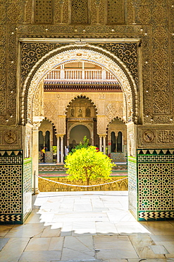 Patio de las Doncellas from interior of room with arabic mosaic walls and archways, Real Alcazar, UNESCO World Heritage Site, Seville, Andalusia, Spain, Europe