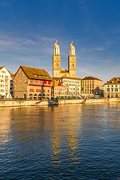 Sunset over Grossmunster Cathedral and Limmatquai street along the banks of Limmat River, Zurich, Switzerland, Europe