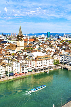 Elevated view of Limmat River and St. Peter church from tall towers of Grossmunster Cathedral, Zurich, Switzerland, Europe
