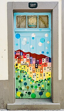Colorful painted door in the old alley of Rua de Santa Maria, Funchal, Madeira island, Portugal