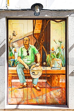 Frescoes paintings on door in Rua de Santa Maria, famous street in the old town of Funchal, Madeira island, Portugal