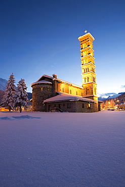 Dusk and lights on the church surrounded by snow Sankt Moritz, Engadine, Canton of Grisons (Graubunden), Switzerland, Europe