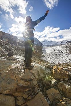 Hiker admires Forni Glacier, Cedec Valley, Stelvio National Park, Valtellina, Lombardy, Italy, Europe