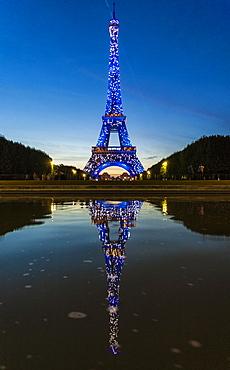 Colored lights illuminate the Eiffel Tower, Champ de Mars, Paris, France, Europe