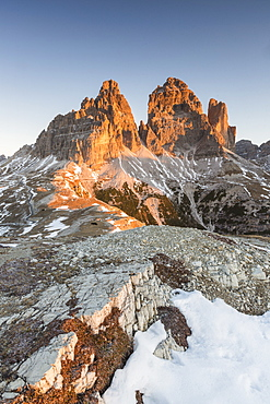 The lights of sunrise frames the Three Peaks of Lavaredo, Dolomites, Auronzo of Cadore, Veneto, Italy, Europe