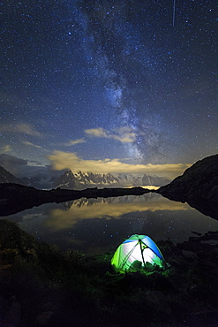 Camping under the stars and Milky Way on the shores of Lac de Cheserys, Chamonix, Haute Savoie, French Alps, France, Europe