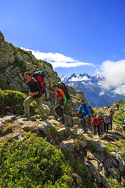 Hikers on the rocky paths around Lac De Cheserys on a sunny summer morning, Chamonix, Haute Savoie, French Alps, France, Europe