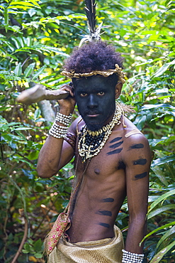 Traditional dressed man holding a spear, Ekasup Cultural Village, Efate, Vanuatu, Pacific