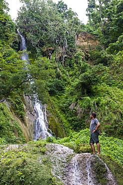 Man standing underneath the Mele Cascades, Efate, Vanuatu, Pacific