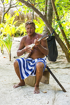 Local man playing the Ukulele, Bora Bora, Society Islands, French Polynesia, Pacific
