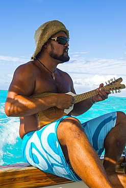 Local man playing the Ukulele, Bora Bora, Society Islands, French Polynesia, Pacific