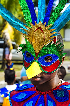 Boy in a carnival costume at the Carnival of Montserrat, British Overseas Territory, West Indies, Caribbean, Central America