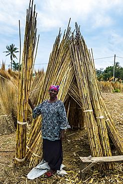 Friendly woman sells reeds on the shores of Lake Tanganyika, Bujumbura, Burundi, Africa