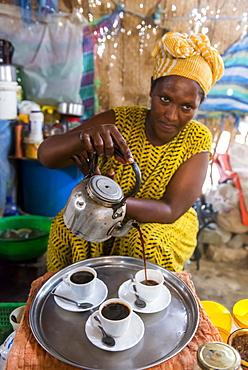 Woman serving Ethiopian coffee, Danakil depression, Ethiopia, Africa