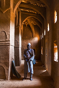 Imam praying in a beautiful Hausa style architecture Mosque in Yaama, Niger, West Africa, Africa