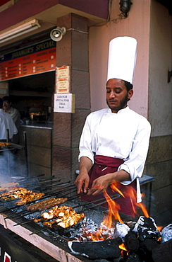 Street kitchen, pakistan. Islamabad. Roasting chicken at a food stall