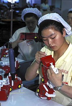 Factory assembly line, china. Guangdong province. Women working in a toy factory