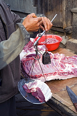 China vendors selling meat at the market place in a village in yunnan province