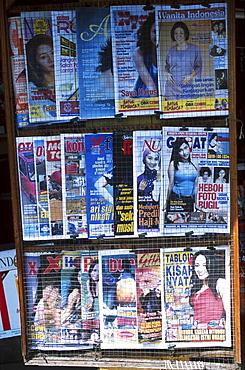 Street life, indonesia. Jakarta. Magazine stand