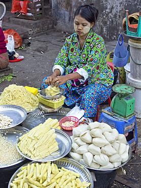 Women vendor at market place in Yangon (Rangoon), Myanmar (Burma), Asia