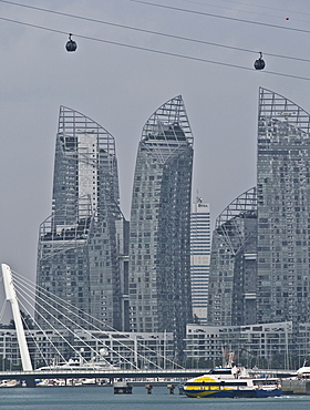 Reflections award-winning skyscrapers at Keppel Bay by Sentosa Island, with cable car in foreground, Singapore, Southeast Asia, Asia