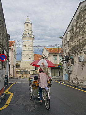 Tourists on bicycles in Penang, Malaysia, Southeast Asia, Asia